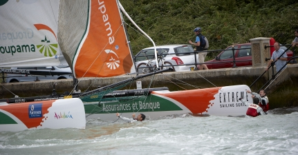 Franck Cammas and Groupama 40 Crew In The Water After Collision with Boat and Wall ( Photo by Mark Lloyd / Lloyd Images / OC Events )